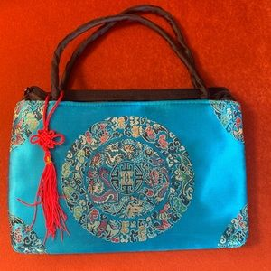 Blue tassel hand bag
